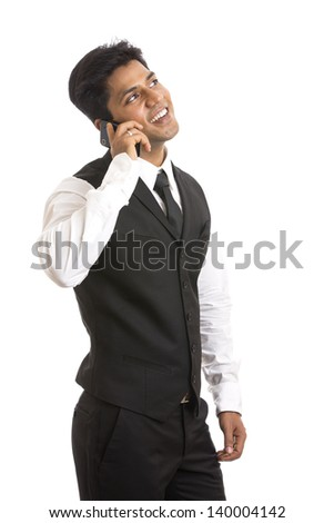 Indian young businessman talking in mobile phone on white background. - stock photo