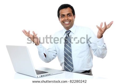 Indian young businessman welcoming with laptop isolated on white. - stock photo