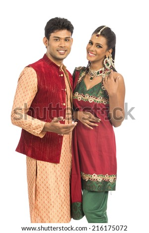 Indian young couple greeting in traditional dress isolated on white. - stock photo