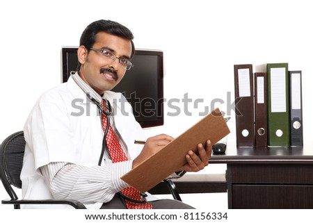 Indian young doctor in hospital computer desk isolated on white