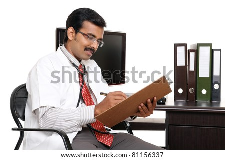 Indian young doctor in hospital computer desk isolated on white - stock photo