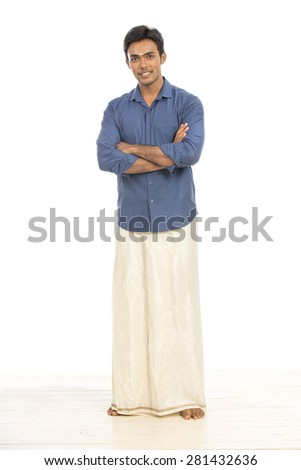 Indian young man in traditional dress on white background. - stock photo