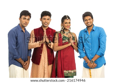 Indian young people greeting in traditional dress isolated on white. - stock photo