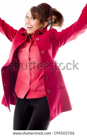 Indian young woman jumping in air and laughing - stock photo