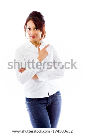 Indian young woman pointing backwards - stock photo