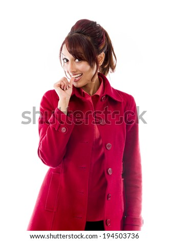 Indian young woman smiling with finger in mouth - stock photo