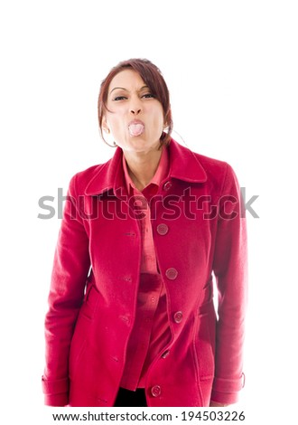 Indian young woman sticking out her tongue - stock photo