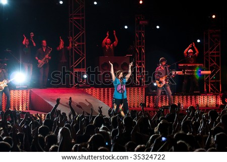 INDIANAPOLIS - AUGUST 14: Singer Kelly Clarkson  performs at the Indiana State Fair on August 14, 2009 in Indianapolis, Indiana - stock photo