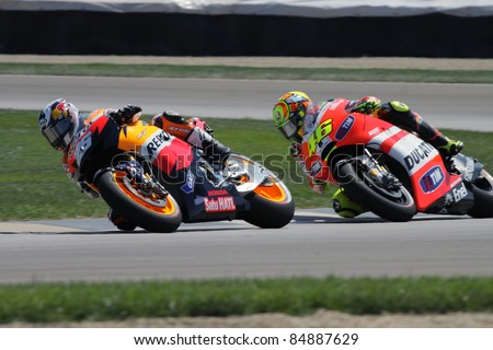 INDIANAPOLIS - AUGUST 26: Spanish Honda rider Dani Pedrosa (L) at 2011 Red Bull MotoGP of Indianapolis on August 26, 2011 in Indianapolis, IN. - stock photo