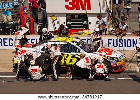 INDIANAPOLIS, IN - JULY 26: Greg Biffle gets his car service during the AllState 400 race at the Indianapolis Motor Speedway on July 26, 2009 in Indianapolis Indiana - stock photo