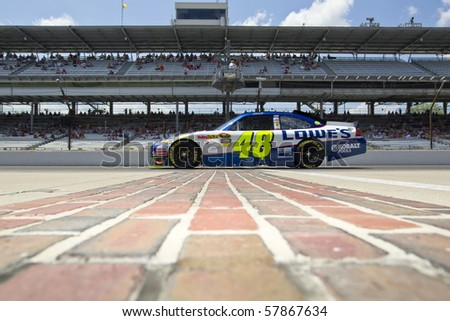 INDIANAPOLIS, IN - JULY 23:  Jimmie Johnson brings his Lowe's Chevrolet down pit road for the Brickyard 400 race at the Indianapolis Motor Speedway on July 23, 2010 in Indianapolis, IN. - stock photo