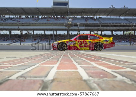 INDIANAPOLIS, IN - JULY 23:  Kevin Harvick brings his Shell Chevrolet down pit road for the Brickyard 400 race at the Indianapolis Motor Speedway on July 23, 2010 in Indianapolis, IN. - stock photo