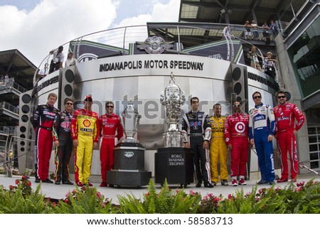 INDIANAPOLIS, IN - JULY 25:  The past NASCAR Sprint Cup winners of the Brickyard at  the Indianapolis Motor Speedway take a photo in Indianapolis, IN on July 25, 2010. - stock photo