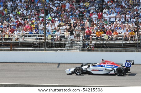 INDIANAPOLIS, IN - MAY 30: Indy car driver hideki mutoh is running in the Indy 500 race May 30, 2010 in Indianapolis, IN - stock photo