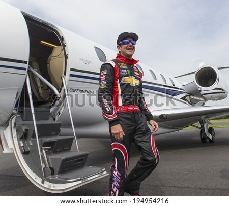 Indianapolis, IN - May 25, 2014:  NASCAR driver, Kurt Busch (26), boards his Cessna Citation X for his trip to Concord, NC to run the Coca-Cola 600 at Charlotte Motor Speedway.   - stock photo