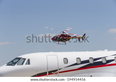 Indianapolis, IN - May 25, 2014:  NASCAR driver, Kurt Busch, lands at Indianapolis Airport and climbs on board his Cessna Citation X and travels to Concord NC to run the Coca-Cola 600 NASCAR race.    - stock photo