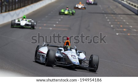 Indianapolis, IN - May 25, 2014:  NASCAR driver, Kurt Busch (26), runs the 98th annual Indianapolis 500 at the Indianapolis Motor Speedway in Indianapolis, IN.   - stock photo