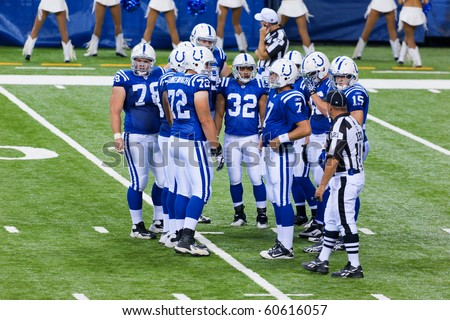 INDIANAPOLIS, IN - SEPT 2: Indianapolis Colt huddle during football game between Indianapolis Colts and Cincinnati Bengals on September 2, 2010 in Indianapolis, IN - stock photo