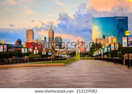 INDIANAPOLIS, INDIANA, JUNE 25, 2014: Indianapolis downtown as seen from the pedestrian bridge across White River. JW Marriott building is the newest addition to the city skyline - stock photo