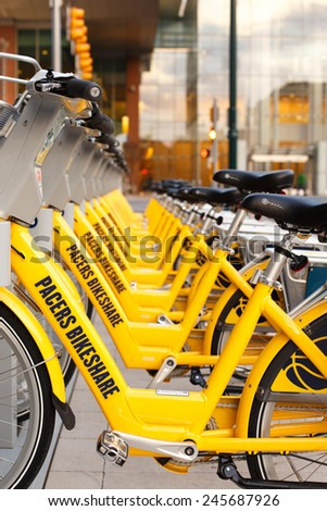 INDIANAPOLIS, INDIANA, USA - MAY 6, 2014: A row of rental bikes operated by Indiana Pacers Bikeshare in front of the Convention Center