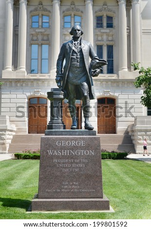 INDIANAPOLIS - JUNE 16:  Statue of George Washington, one of many statues surrounding the Indiana Statehouse, is shown here on June 16, 2014. - stock photo