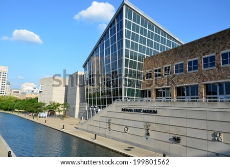 INDIANAPOLIS - JUNE 17:  The Indiana State Museum, shown here on June 17, 2014, includes sculptures representing each of Indiana's 92 counties, including the ones shown on the canal-facing wall.  - stock photo