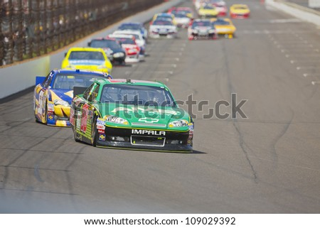 INDIANPOLIS, IN - JUL 29, 2012:  Dale Earnhardt, Jr. (88) brings his car down the front stretch during the Curtiss Shaver race at the Indianapolis Motor Speedway in Indianapolis, IN on 29 Jul, 2012. - stock photo