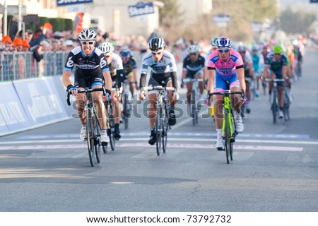 INDICATORE, AREZZO, ITALY - MARCH 10: Tyler Farrar, Team Garmin Cervelo wins the sprint of 2nd stage of 2011 Tirreno-Adriatico, 2nd arrived Petacchi, 3rd Haedo on March 10, 2011 in Indicatore, Arezzo, Italy
