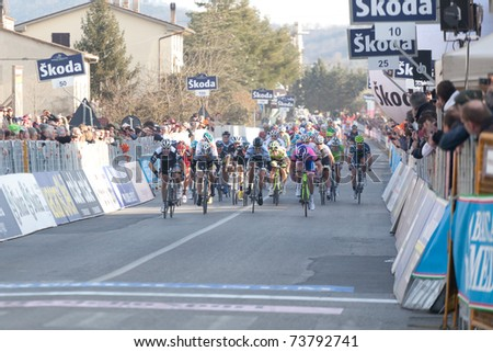 INDICATORE, AREZZO, ITALY - MARCH 10: Tyler Farrar, Team Garmin Cervelo wins the sprint of 2nd stage of 2011 Tirreno-Adriatico, 2nd arrived Petacchi, 3rd Haedo on March 10, 2011 in Indicatore, Arezzo, Italy - stock photo
