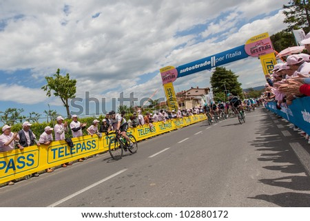 INDICATORE, AREZZO, ITALY - MAY 16: Cyclists at intermediate finish during the 11th stage of 2012 Giro d'Italia on May 16, 2012 in Indicatore, Arezzo, Italy - stock photo