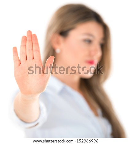 Indifferent woman talk to the hand portrait - isolated over white  - stock photo