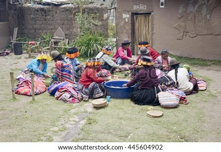 Indigenous women cutting potatoes for a local wedding ceremony, Paru Paru, the highest-altitude community in La Parque de la Papa, Andes Mountains. October 22, 2012 - Paru Paru, Peru - stock photo
