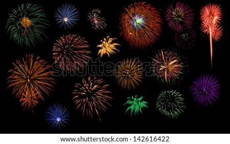 Individual colorful fireworks isolated on black background. - stock photo