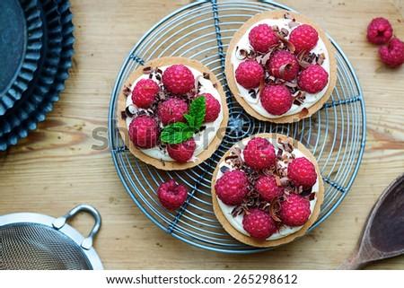 Individual raspberry tarts top view - stock photo