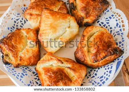 Individual-sized baked or fried buns stuffed with a variety of fillings. - stock photo