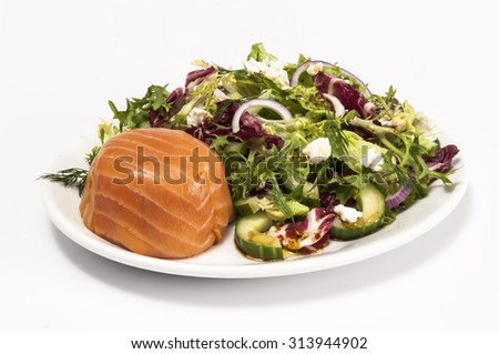 Individual smoked salmon terrine with a mixed green salad isolated on white - stock photo