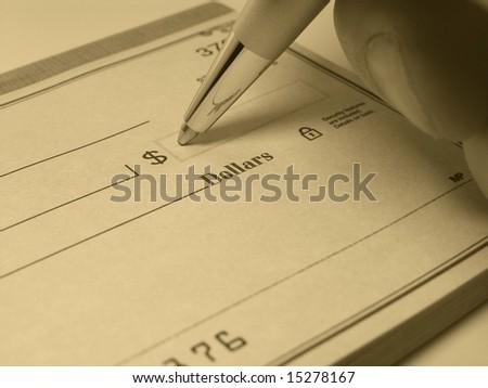 Individual writing a check - stock photo
