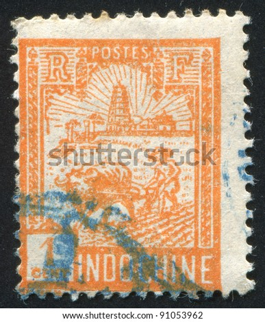 INDO-CHINA CIRCA 1927: stamp printed by Indo-China, shows Plowing near Tower of Confucius, circa 1927