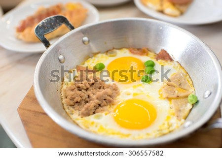 Indochina pan-fried egg with pork and toppings, Breakfast food in Thai style - stock photo