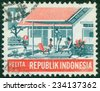 """INDONESIA - CIRCA 1969: A stamp printed in Indonesia from the """"Five-year Development Plan"""" issue shows Modern family (Social Welfare), circa 1969. - stock photo"""