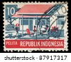 INDONESIA-CIRCA 1979:A stamp printed in Indonesia shows image of family members in the backyard, circa 1979. - stock photo
