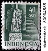 INDONESIA - CIRCA 1943-45: A stamp printed in Indonesia shows lion, vanquishes the serpent, circa 1943-45 - stock photo