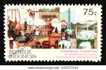 INDONESIA - CIRCA 1990: Postage stamp printed in Indonesia with colorful collage of people and structure to commemorate Indonesia-Pakistan economic and cultural cooperation organization. - stock photo