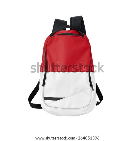 Indonesia flag backpack isolated on white background. Back to school concept. Education and study abroad. Travel and tourism in Indonesia - stock photo