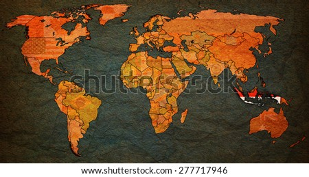 indonesia flag on old vintage world map with national borders - stock photo