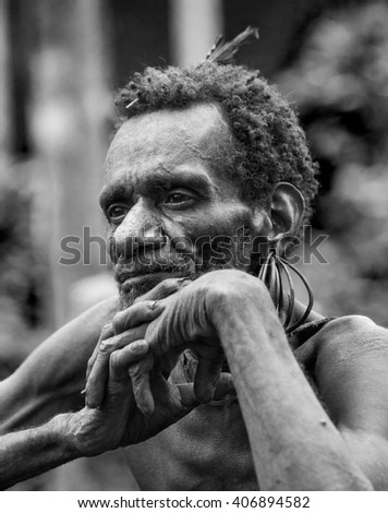 INDONESIA, ONNI VILLAGE, NEW GUINEA - JUNE 24: Portrait of a man Korowai tribe. Close-up. Tribe of Korowai (Kombai , Kolufo).On June 24, 2012 in Onni Village, New Guinea, Indonesia