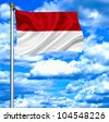 Indonesia waving flag against blue sky - stock photo