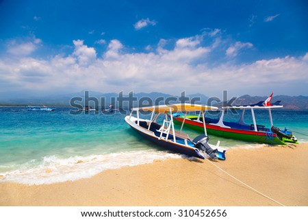 Indonesian boats on tropical beach
