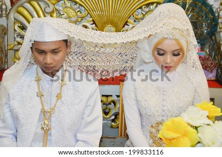 Indonesian bridal couples were undergoing the marriage ceremony event - stock photo