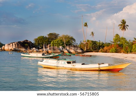 Indonesian fishing boats in small harbor - stock photo